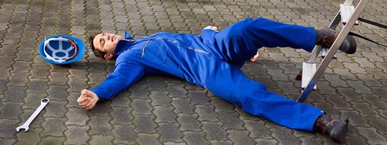 worker lays on floor after workplace accident